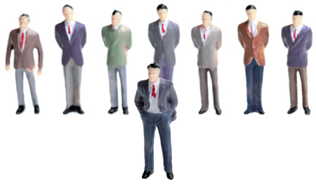 individualism: Leadership Figurine Concept Isolated on White Background Editorial