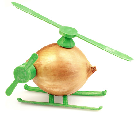 transposition: Conceptual Helicopter Toy Made with Onion and Plastic Stock Photo