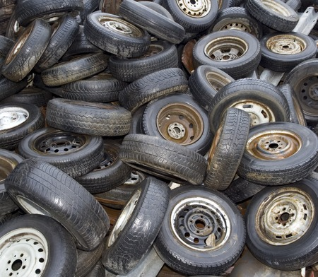 junk yard: Old Tyres at Junk Yard Background Stock Photo