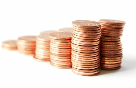 penny pinching: Stacks of pennies against a white background