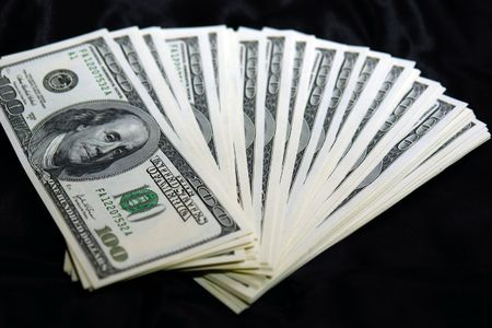 fanned: stack of USD fanned out on black satin background