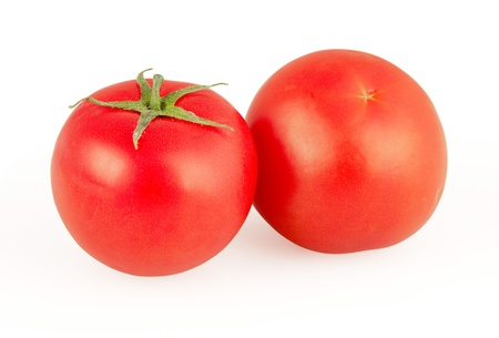 Red tomatoes isolated on white background photo