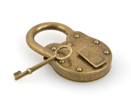 Padlock and key isolated on white background photo