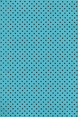 Cyan paper background with polka dot pattern photo