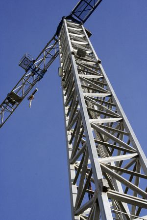 detail of a crane against blue sky Stock Photo