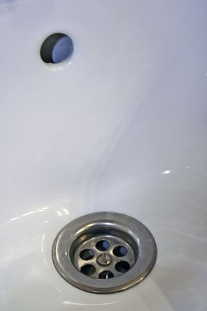 neccessary: detail of a sink with two drains Stock Photo
