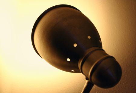 designed lamp creating light on wal