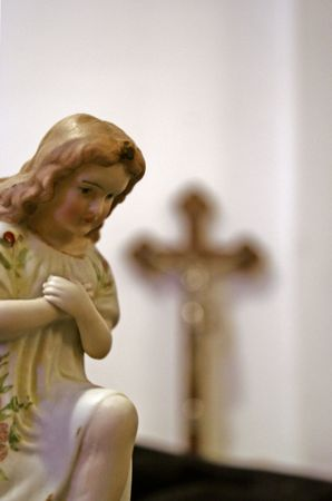 praying angel with crucified