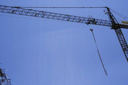 building crane against blue sky Stock Photo