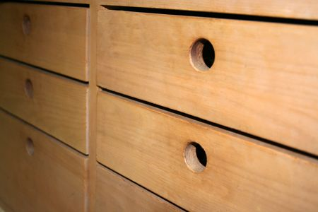 Wooden drawers with holes as handles