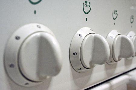 detail of three white gasknobs Stock Photo