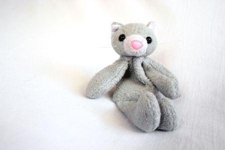 stuffed toy cat sitting photo