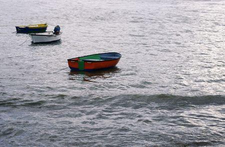 three little boats at sea Stock Photo