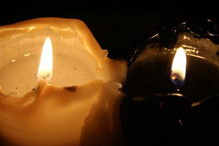 burning black and white candle  Stock Photo