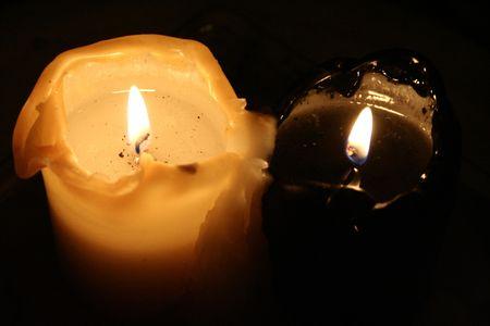 black and white candle burning