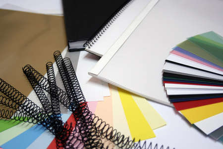 books, spirals, paper and colorchart Stock Photo
