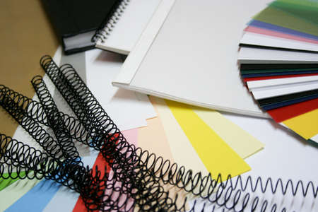 different books, binding material, colorchart and paper