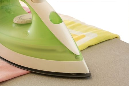 Ironing board with iron against white background Stock Photo