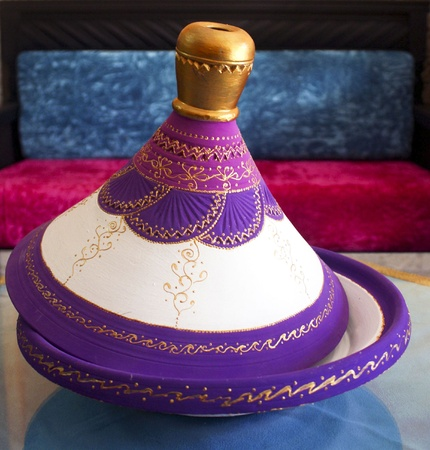 Traditional maroccan tajine in purple shades photo