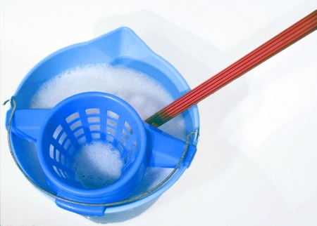 black appliances: Blue bucket with water, soap and red mop