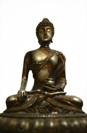 golden buddha against white  background