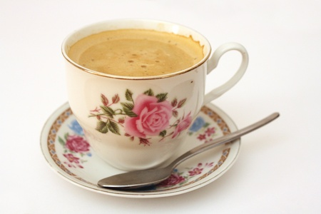 coffee cup with dish and spoon