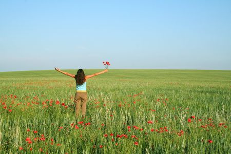 Green field Landscape with young girl photo