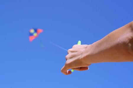 kiting: Hand of the girl with a kite. Focus on a hand.