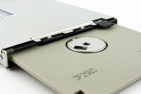 macro of laptop floppy drive with diskette photo