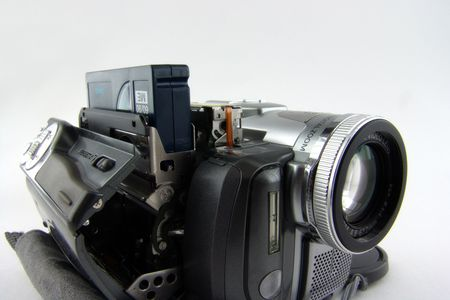 substitution: cassette replacement in digital video camera Stock Photo