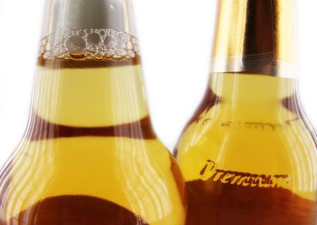macro of two bottles with premium beer in soft light photo
