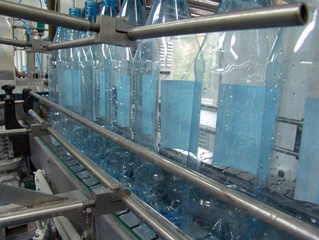 bottling soda-water on the plant Stock Photo