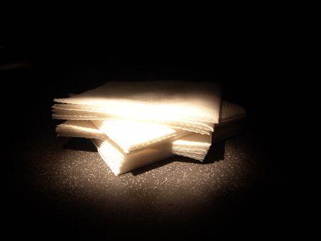 white napkin in sport light isolated on black photo
