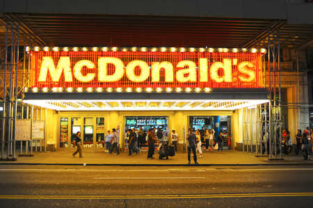 newyork: NEW-YORK, USA - SEPTEMBER 28, 2011: McDonalss restaurant facade. The McDonalds Corporation is the worlds largest chain of hamburger fast food restaurants, serving around 68 million customers daily in 119 countries across 35,000 outlets