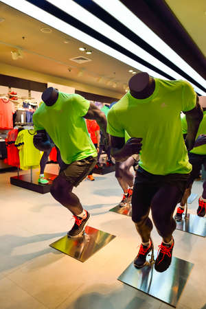 adidas: BANGKOK, THAILAND - JUNE 21, 2015: shopping center interior. Shopping malls and department stores such as Siam Paragon, Central World Plaza, Emperium, Gaysorn and Central Chidlom become shopping Mecca for shopaholics