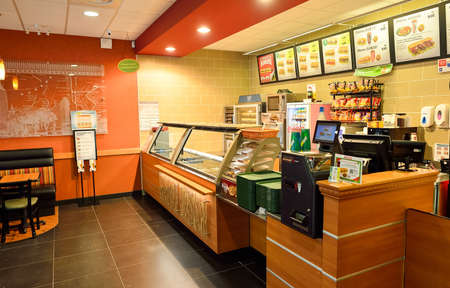 primarily: NICE, FRANCE - AUGUST 15, 2015: Subway fast food restaurant interior. Subway is an American fast food restaurant franchise that primarily sells submarine sandwiches (subs) and salads. Editorial