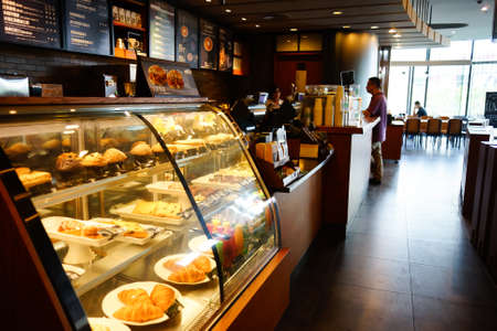 coffeehouse: SHENZHEN, CHINA - OCTOBER 13, 2015: Starbucks Cafe interior. Starbucks Corporation is an American global coffee company and coffeehouse chain based in Seattle, Washington