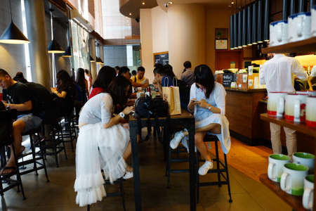 coffeehouse: SHENZHEN, CHINA - OCTOBER 15, 2015: Starbucks Cafe interior. Starbucks Corporation is an American global coffee company and coffeehouse chain based in Seattle, Washington