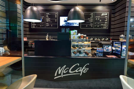 almost all: DUBAI, UAE - SEPTEMBER 08, 2015: McCafe in Dubai Airport. There are a lot of restaurants, bars, cafes and shops in Dubai International Airport. Almost all of them are open twenty-four hours. Editorial