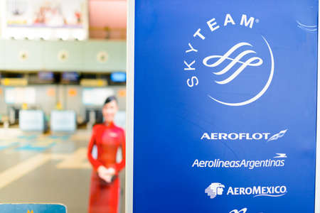 alliances: HANOI, VIETNAM - MAY 11, 2015: close-up shot of banner with SkyTeam logo. SkyTeam was the last of the three major airline alliances to be formed, the first two being Star Alliance and Oneworld.