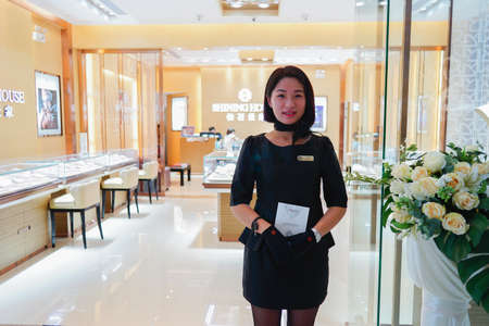 shop assistant: SHENZHEN, CHINA - OCTOBER 13, 2015: shop assistant in the luxury jewellery store. Shenzhen excellent shopping choices and offers tourists great shopping opportunities.
