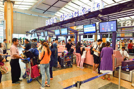 avia: SINGAPORE - NOVEMBER 07, 2015: check-in zone at Changi Airport. Singapore Changi Airport, is the primary civilian airport for Singapore, and one of the largest transportation hubs in Southeast Asia