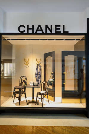 haute couture: SINGAPORE - NOVEMBER 08, 2015: shop window of Chanel store. Chanel S.A. is a high fashion house that specializes in haute couture and ready-to-wear clothes, luxury goods and fashion accessories