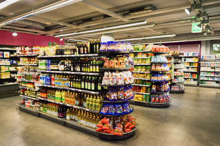 grocery shelves: GENEVA, SWITZERLAND - SEPTEMBER 18, 2015: interior of Migros supermarket. Migros is Switzerlands largest retail company, its largest supermarket chain and largest employer