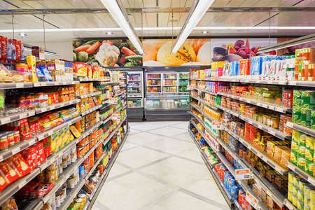 shelves: GENEVA, SWITZERLAND - SEPTEMBER 19, 2015: interior of Migros supermarket. Migros is Switzerlands largest retail company, its largest supermarket chain and largest employer