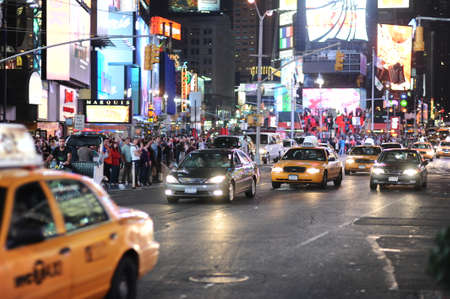 str: NEW YORK - SEPTEMBER 28: area near Times Square at night on September 28, 2011 in New-York, USA. Times Square is a major commercial intersection and a neighborhood in Midtown Manhattan, New York City, at the junction of Broadway and Seventh Avenue and str