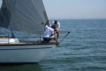 maneuvering: Two seamen and one sail. Work of a team. It is necessary to be first.