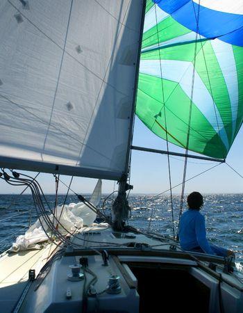 peace risk: Under sails. The man dreams sitting under sails. Looks far. Beautiful sails and beautiful dreams.