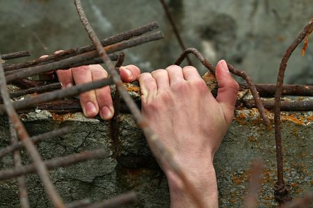 The hand of the man which wants freedom. Stock Photo - 926422