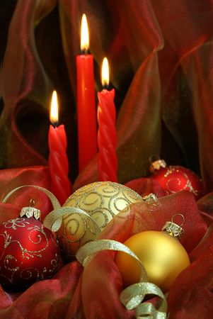 Christmas Candles & Baubles on a red background.  photo